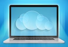 Laptop computer and a cloud storage on blue Royalty Free Stock Photo