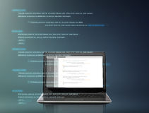 Laptop computer with coding on screen Stock Image