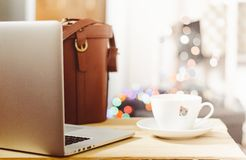 Laptop computer with coffee cup Royalty Free Stock Photos