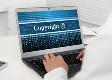 Laptop computer with Copyright message Royalty Free Stock Images