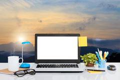 Laptop computer on desk and landscape view background stock photography
