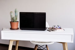 Laptop computer  on a desk in office Stock Images