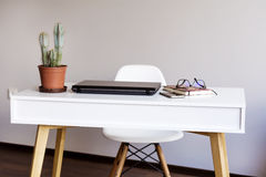 Laptop computer  on a desk in office Stock Photos