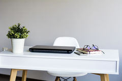 Laptop computer  on a desk in office Royalty Free Stock Photos