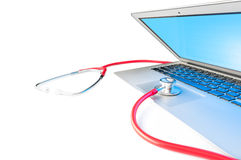 Laptop computer diagnostic and repait concept. Open silver laptop with blue screen isolated on white background. Red stethoscope on computer. Online repair and royalty free stock photo