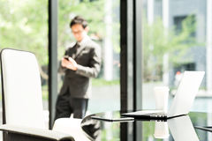 Laptop computer, digital tablet, and coffee on executive or manager table in modern office of Asian businessman or entrepreneur. Laptop computer, digital tablet Stock Images