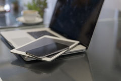 laptop computer, digital tablet and mobile phone on black table Royalty Free Stock Photo