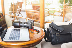 Laptop computer and dslr camera at cafe Royalty Free Stock Photo