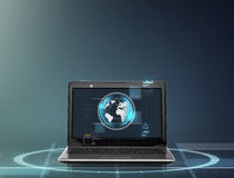 Laptop computer with earth globe on screen Royalty Free Stock Images