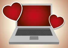 Laptop computer emitting two valentines hearts Royalty Free Stock Photo