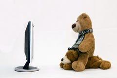 LAPTOP COMPUTER en TEDDYBEER Stock Afbeeldingen