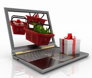 Laptop computer with festive shopping  baskets. Concept of Christmas online shopping. 3d illustration. Laptop computer with festive shopping  baskets on white Stock Photography