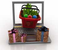 Laptop computer with festive shopping baskets on white background. Concept of Christmas online shopping. 3d illustration. Laptop computer with festive shopping Royalty Free Stock Photos