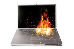 Laptop computer on fire Royalty Free Stock Images
