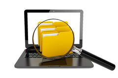 Laptop computer with folders and magnifier. On a white background Royalty Free Stock Photography