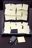 Laptop computer full of blank post-it reminders Royalty Free Stock Photo