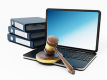 Laptop computer, gavel and folders Stock Photography
