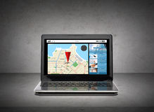 Laptop computer with gps navigator map on screen Stock Photography