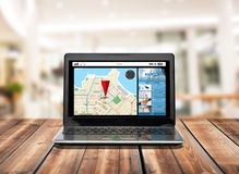 Laptop computer with gps navigator map on screen Royalty Free Stock Photo