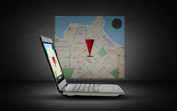 Laptop computer with gps navigator map on screen Royalty Free Stock Photography
