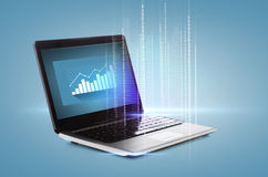 Laptop computer with graph on desktop. Technology and advertisement concept - laptop computer with graph on desktop Stock Images