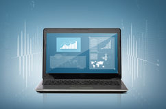 Laptop computer with graph on screen Stock Photos