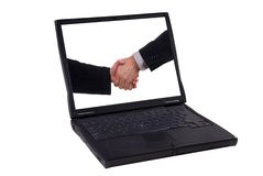 Laptop computer with handshake Stock Photo