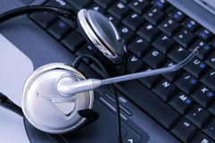 Laptop computer with headset Stock Photography