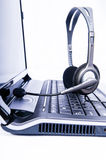 Laptop computer with headset on keyboard. Laptop computer with headset isolated on keyboard Royalty Free Stock Photos