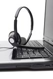 Laptop computer with headset on keyboard Royalty Free Stock Photo