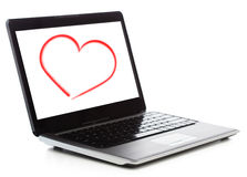 Laptop computer with heart on white screen Stock Photo