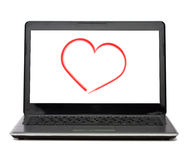 Laptop computer with heart on white screen Stock Photos