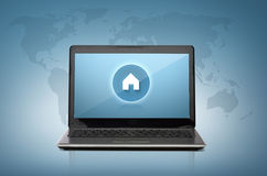 Laptop computer with house button on screen Stock Photography