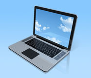 Laptop computer isolated on blue with sky screen Royalty Free Stock Photography