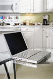 Laptop computer on kitchen. Stock Images