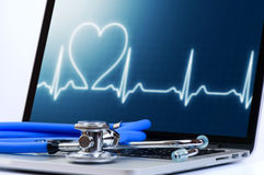 Laptop computer with medical cardiologic test software and stethoscope. Healthcare concept. laptop computer with medical cardiologic diagnostic test software and royalty free stock image
