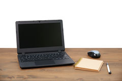 Laptop computer and memo note with ballpoint pen Stock Images