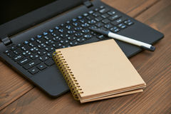 Laptop computer and memo note with ballpoint pen Stock Image