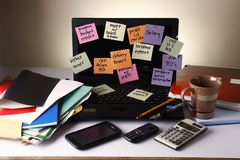 Laptop computer with messages on colorful papers, cellphone, smartphone, notebook, pen, pencil and eyeglasses Royalty Free Stock Photos