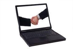 Laptop-Computer mit Händedruck Stockfoto