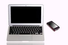Laptop computer and mobile phone Stock Photography