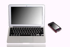 Laptop computer and mobile phone, Mirror monitor Stock Image