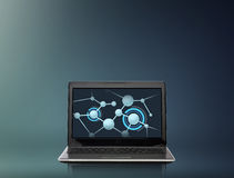 Laptop computer with molecules structure on screen Royalty Free Stock Photo