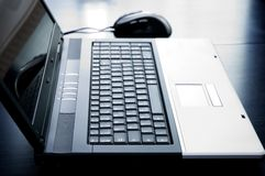 Laptop computer with mouse Royalty Free Stock Photography
