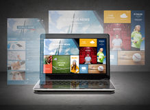 Laptop computer with news web pages on screen Royalty Free Stock Images