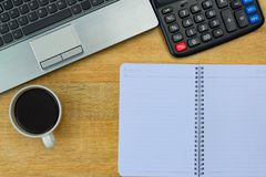 Laptop computer or notebook, calculator and cup of coffee on wor. Laptop computer or notebook, calculator and cup of coffee  on working table or desk, work space Royalty Free Stock Images