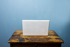Laptop computer on old wood desk Royalty Free Stock Photos