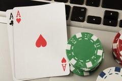 Laptop computer and online gambling theme stock photos
