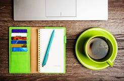 laptop computer, planner, cup of tea Stock Photo