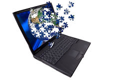 Laptop computer with puzzle Royalty Free Stock Photo